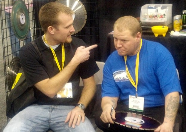 Customer Pointing at Jeff Compton of Desert Diamond Industries at World of Concrete