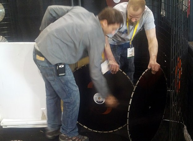 Glen Hellebrand and Gionni Mione with Big Saw Blades during Setup at World of Concrete 2013