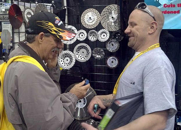 Glen Hellebrand of Desert Diamond Industries with Customer at World of Concrete 2013