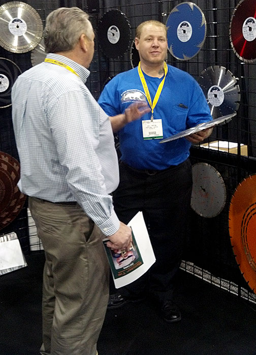 Jeff Compton of Desert Diamond Industries Selling Blade to Customer at World of Concrete 2013