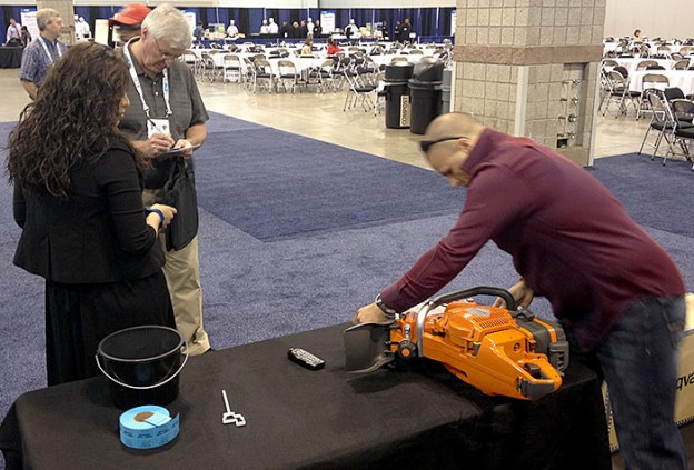 June 11, Nicholas Mione Showing Off the Husqvarna K970 Ring Saw at ACE13