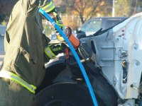 Firefighter with Hydraulic Cutter, courtesy of Fire Engineering Magazine