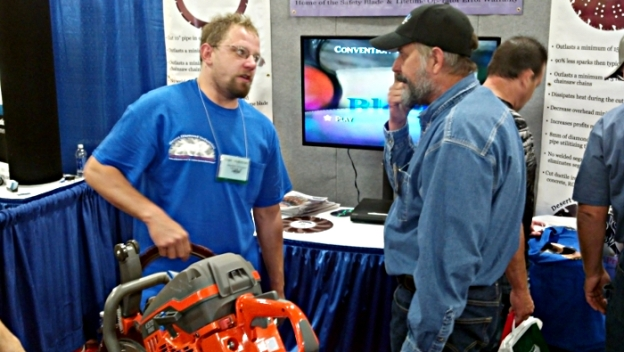 Glen Hellebrand Showing Off Ductile Iron Safety Blade at Tri-State Seminar On-The-River