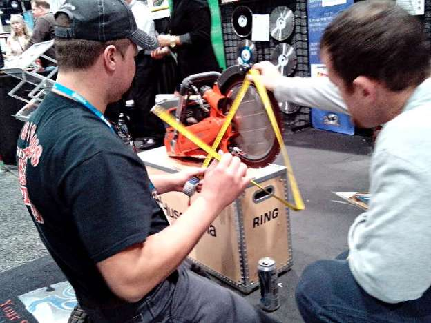 Customers Measuring Husqvarna K970 Ring Saw at World of Concrete 2014
