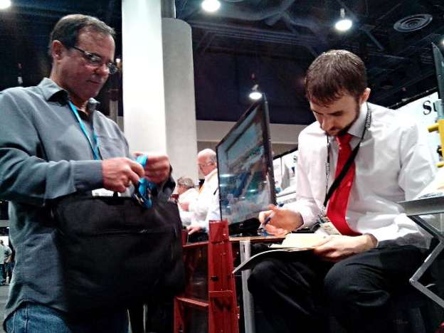 Gionni Mione of Desert Diamond Industries Writing Up Customer at World of Concrete 2014