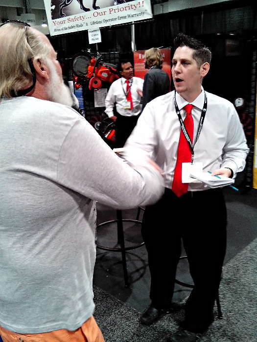 Mike Harris Shaking a Customer's Hand at World of Concrete 2014