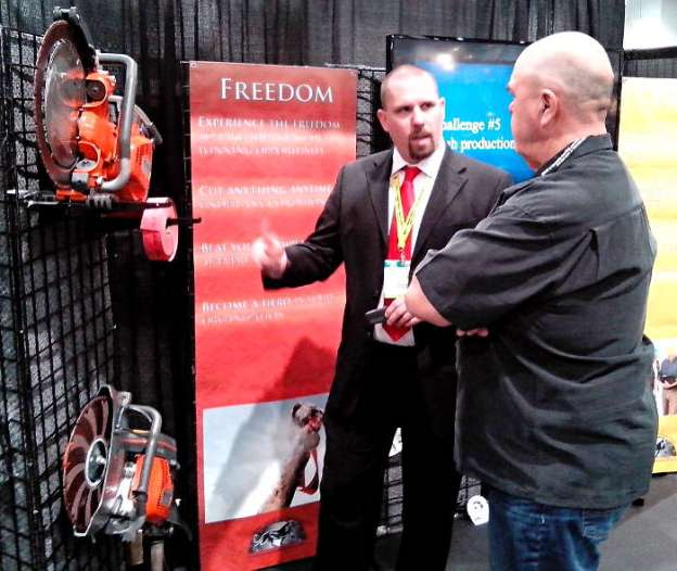 Troy Fullerton of Desert Diamond Industries with Customer at World of Concrete 2014
