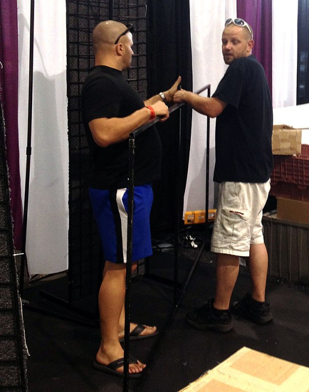 Nicholas Mione and Glen Hellebrand Setting Up Booth at ACE14, June 7